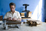Clay Carlton (CQ) of Denver demonstrates how he rolls cigars at his Palma Cigar Co. The cigar...
