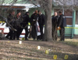 Denver police remove evidence from the scene of a deadly shooing outside a home in the 1300 block...