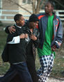 Lekasha Kirk (cq),center,  is led away as Denver police investigate the scene of a deadly shooing...