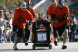 The Royal Tavern race team pushes uphill during the 2007 Emma Crawford Coffin Race and Parade,...