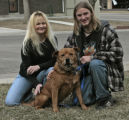 Romeo, center, has been adopted by Kimberly Cupp-Moore (cq), left and her son Chris Moore (cq) at...
