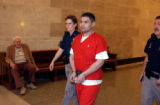(DENVER, CO, SEPTEMBER 28, 2004)  Robert Zamora is escorted out of a courtroom on Tuesday, Sept....