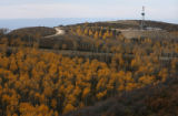 MJM406  A natural gas rig  operated by Williams Energy is surrounded by colorful aspens as it sits...
