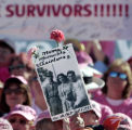 (Denver, Colo., October 3, 2004) Breast cancer survivor Rose Martinezt holds up a sign in honor of...