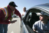 Vounteer Larry Jack, working at the City's main water tower, left,  warns  his children Bailey,...