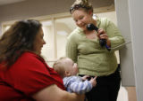 (at right) 24 year-old Kinzie Cuba (cq) of littleton visits the father of her 7 month-old son...