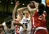 003 (5A) Highlands Ranch Falcons' #15 Taylor Johnson, center, struggles to keep control of the...