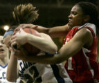 147 (5A) Highlands Ranch Falcons' #22 Melisa Ryba, left, gets fouled by Regis Jesuit Raiders' #21...