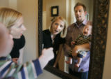393 Shelley and Jason Martinkus use a mirror to try and calm down their son  Truman, 3 mo. as he...