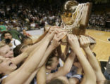 519 (4A) Broomfield Eagles' #22 Maddie Reeves and her teammates hoist the 5A trophy as they...