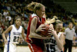 252 (5A) Regis Jesuit Raiders' # 11 Kelsey Roben, left and Highlands Ranch Falcons' #15 Taylor...
