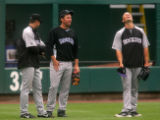 Matt Holliday, right, laughs while hanging out in the outfield with Troy Tulowitzki, left, and...