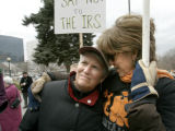 090 Ellen Stark, left, gets a hug from her sister Amy Haywood, right, during a war protest on the...