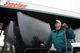 Charlie Quail (cq) 56, pauses after fueling and washing the windows of his 18 wheeler at the Sapp...