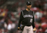 Jeff Francis walks off the mound in the rains at the bottom of the 3rd inning of the Colorado...