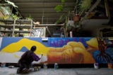 DM1299   Lady Pink, a world renowned graffiti artist from New York, works on a mural in a Denver...