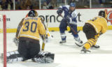 Air Force forward Josh Frider (11) takes a shorthanded shot on Colorado College goalie Richard...