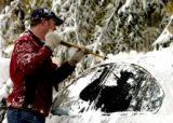 (LOVELAND BASIN, Colo., October 13, 2004)  Mike Pinkston clears 12 inches on new snow off the...