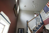 524 Amber carries her daughter Leia Baum upstairs for her nap at their home in Gettysburg Pa.,...
