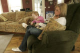 377 Amber and Leia Baum, wife and daughter of Sgt. Ryan John Baum, spend time together at their...