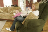 375 Amber and Leia Baum, wife and daughter of Sgt. Ryan John Baum, spend time together at their...