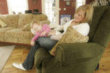 372 Amber and Leia Baum, wife and daughter of Sgt. Ryan John Baum, spend time together at their...