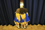 DM0033    Dancers from the Wick School of irish Dance peek out the curtain from back stage to see...