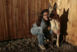 Laura Hagan (cq), with her dog Rolo, in the backyard of her Arvada home, Tuesday evening, March...