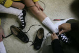 DM0117   Laura Kent helps her daughter Meghan MacLaren lace up her dancing shoes before performing...