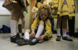 DM0125   Anne Marie Tobler, an dancer with the Wick School of Irish Dance, laces up her shoes...