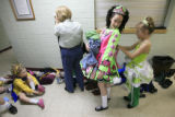 DM0138   Molly Martin, center, gets a little help with her dress from Renae Marshall before...