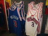 The two Philadelphia 76ers jerseys side by side are at Mitchell & Ness, a retro sporting wear...