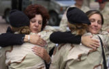 (Colorado Springs, Colo., May 25, 2004) Carol DiRaimondo, left hugs Monique Gilbert, 21, while...