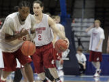 (from left) Washington State University guards, Kyle Weaver (cq) and Derrick Low (cq) practice...