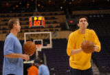Denver Nuggets assistant coach John Welch (left) works with Eduardo Najera at the US Airways...
