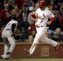 MOJR106 - St. Louis Cardinals' Adam Kennedy, right, scores on a double by Rico Washington as...