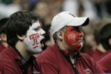 Philadelphia fans (from left) Mike Swartwood (cq) and Doug Piazza (cq), band players for Temple,...
