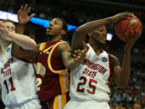 DM0356   Washington State's Kyle Weaver snatches a rebound away from Winthrop's Charles Corbin in...