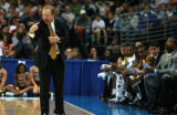 DM0426   Winthrop coach Randy Peele gets riled up in the first half during the first-round of NCAA...