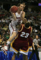 DM0498   Washington State's Derrick Low barrels over and fouls Winthrop's Taj McCullough in the...