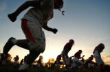 (DENVER, Co., SHOT 10/12/2004) Denver East High School football players run sprints at the end of...