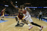 DM0496   Washington State's Kyle Weaver cruises past Winthrop's Mantoris Robinson as he drives to...