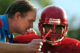 (DENVER, Co., SHOT 9/27/2004) Denver East High School head coach Dave Sidwell (left) tries to get...