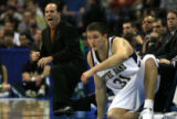 DM0895   Notre Dame head coach Mike Brey yells as he kneels in front of the bench in the first...