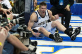 DM0690   Notre Dame's Luke Harrangody is fired up after diving out of bounds for a loose ball in...