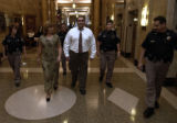 (DENVER Colo., September 29, 2004) Edward Herrara walks down the hall accompanied by his attorney,...