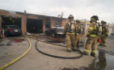 Englewood firemen respond to an explosion and fire at a transmission repair shop at 3935 S. Lipan...