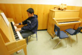 Emanuel Lopez, 15, a sophmore, practices piano in the 8am piano class at Lincoln High School in...