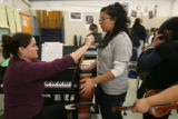 Lincoln High School student Gabriela Valencia, a freshman, tunes her cello with music teacher...