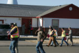 National Guardsmen and CDOT workers canvas a neighborhood to make sure everyone knows that the...